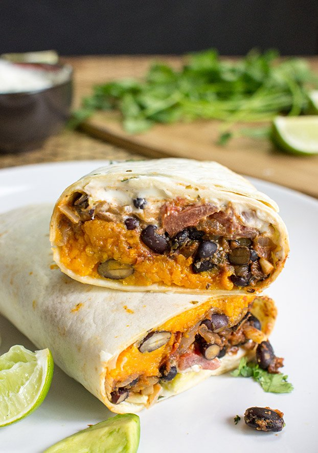 Sweet Potato Burritos - bursting with Mexican flair and tantalising flavours, this authentic recipe is easy to make for one or the whole big family!   hurrythefoodup.com