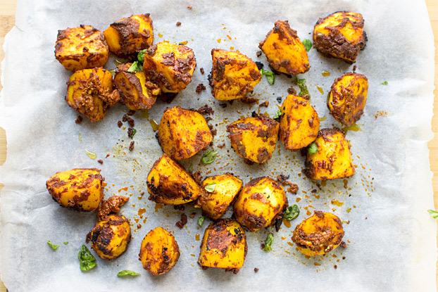 Irish Bombay Potatoes - The Best Curried Potatoes in the World - layer the potatoes over a large oven tray #herbs #indian | hurrythefoodup.com
