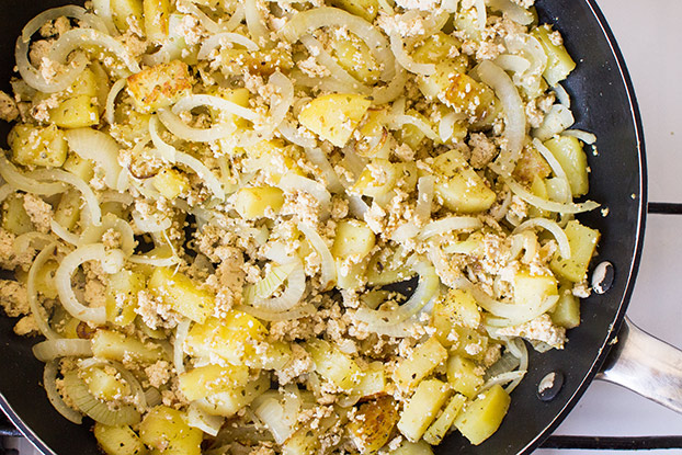 Vegan Breakfast Potatoes - Break the Fast - potatoes are frying in the pan #potato | hurrythefoodup.com