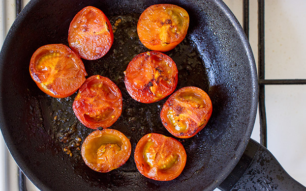 Vegan Breakfast Potatoes - Break the Fast - tomatoes are frying in the pan #tomato | hurrythefoodup.com