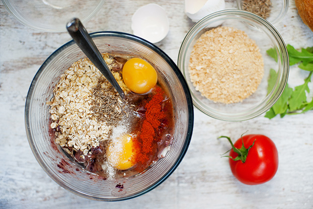 Eggs and breadcrumbs added to a bowl to bind veggie burgers | Hurry The Food Up