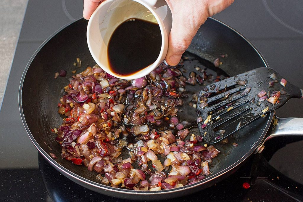 Red Onion Chutney - Sweet and Sour gives us Power - onions are cooking in the large pan #garlic #appetizer | hurrythefoodup.com