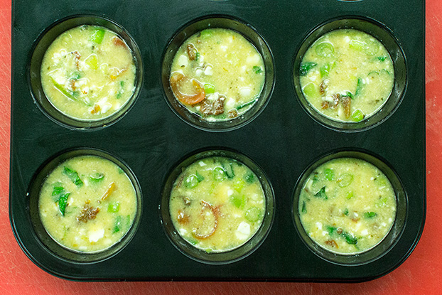 Italian-Style Breakfast Egg Muffins - muffins are ready for baking in muffin slots #feta cheese #salt | hurrythefoodup.com