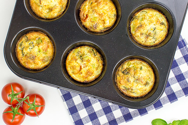 Italian-Style Breakfast Egg Muffins - Italian-Style Breakfast Egg muffins are ready in muffin slots #sun-dried tomatoes #eggs | hurrythefoodup.com