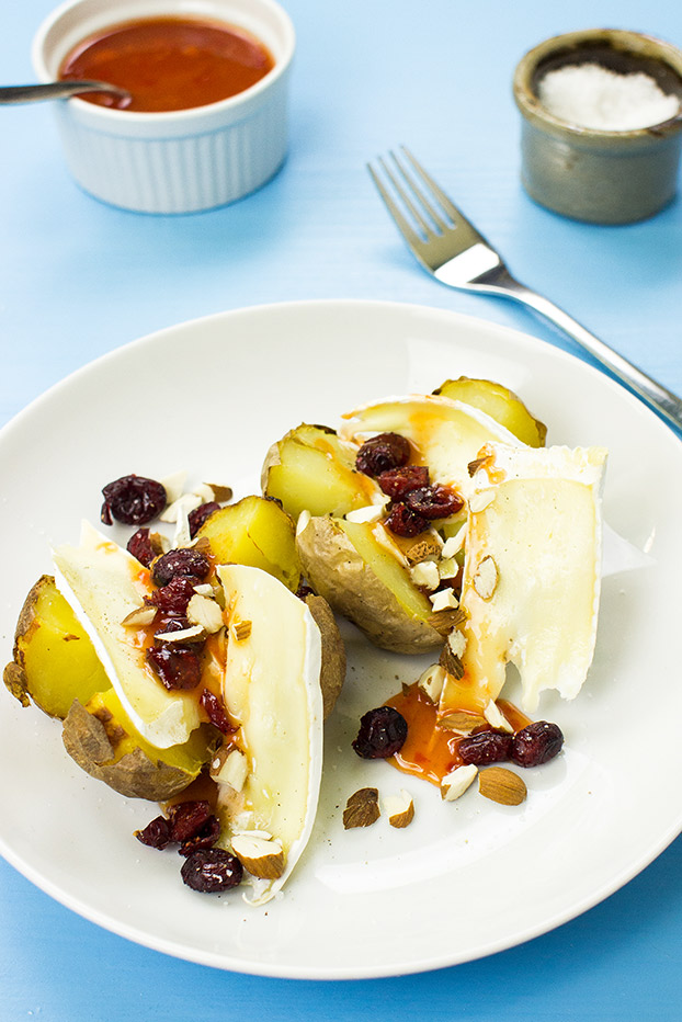 #Microwave Baked Potato – The Ultimate Guide - microwave baked potatoes under a layer of brie and cranberries | hurrythefoodup.com