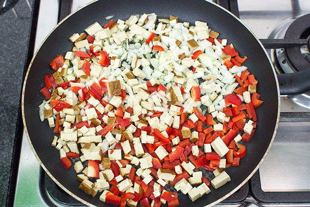 Tofu, onion and pepper are frying in the pan #onion #vegetarian | hurrythefoodup.com