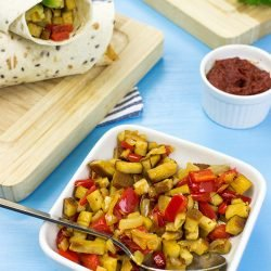 Speedy Vegan Burrito – Packed with Protein - Vegan Burrito is served #pepper #tofu | hurrythefoodup.com