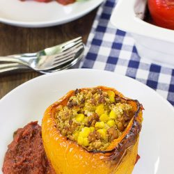 Vegan Stuffed Peppers – Packed with Protein - the stuffed pepper stands on the plate #tempeh #olive oil | hurrythefoodup.com