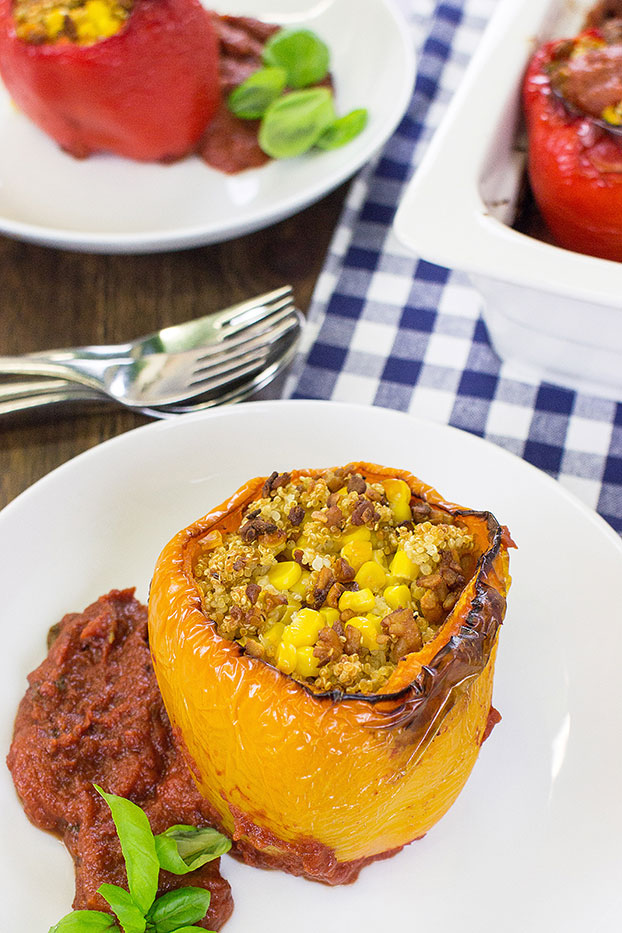 Vegan Stuffed Peppers – Packed with Protein - the stuffed pepper is on the plate #tempeh #olive oil | hurrythefoodup.com