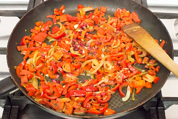 Peppers and onions are frying in the pan #olive oil #garlic | hurrythefoodup.com