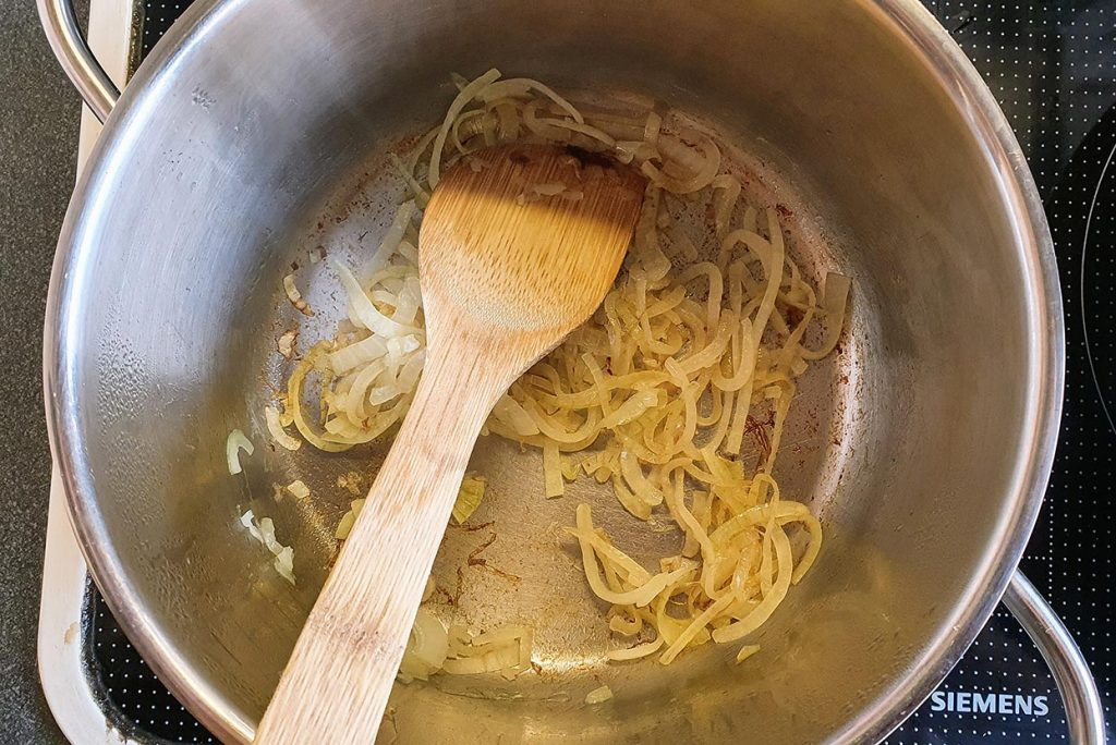 The onions are preparing in the pot #chickpea flour #ginger powder | hurrythefoodup.com