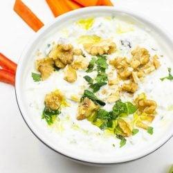The dip is served on the table with chopped veggies #raisins #Greek yogurt | hurrythefoodup.com