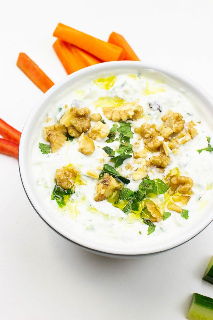 The dip is served on the table with chopped veggies #raisins #Greek yogurt | hurrythefoodup.com