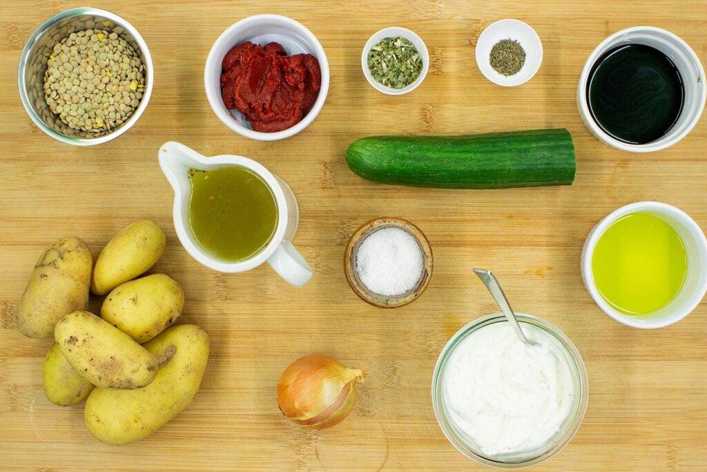 The Crispy Potato Lentil Buddha Bowl ingredients are on the chopping board - lentils, vegetable stock, tomato paste, onion, potatoes, cucumber, sour cream #balsamic vinegar #salt | hurrythefoodup.com