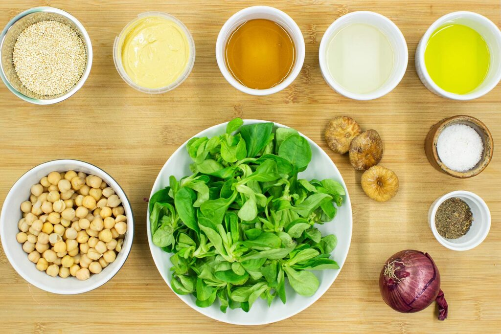The Buddha bowl ingredients are on the chopping board - salad, chickpeas, red onion, figs, mustard, oil #quinoa #chickpeas | hurrythefoodup.com