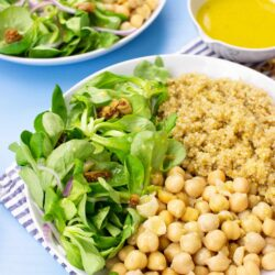 The meal with corn salad are on the table on 2 plates with towel, salt and dressing #olive oil #white vinegar | hurrythefoodup.com