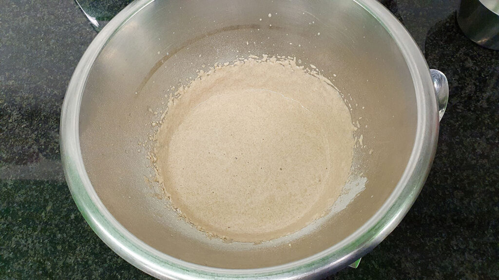 The mix of yeast, water and flour is blended in the mixing bowl #dried Italian herbs #mozzarella | hurrythefoodup.com