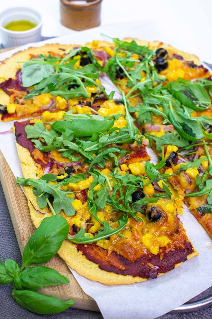 The pizza is served on the paper on a chopping board on a towel with olive oil, salt and basil #salt #tomato paste | hurrythefoodup.com