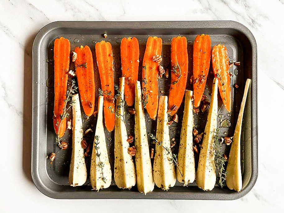 All the ingredients are placed on a baking tray #parsnips #feta | hurrythefoodup.com