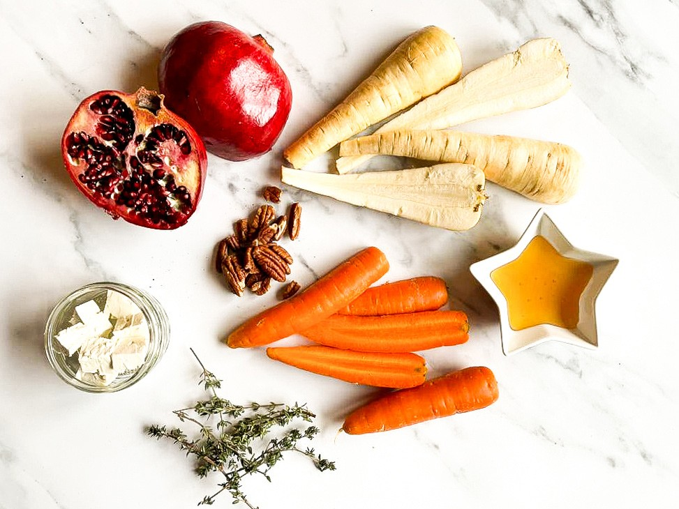 The ingredients are on the table - parsnips, carrots, pomegranate, feta, honey and pecans #rosemary #salt | hurrythefoodup.com
