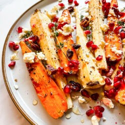 Honey Roasted Carrots & Parsnips are served on the plate on the white table #carrots #honey | hurrythefoodup.com