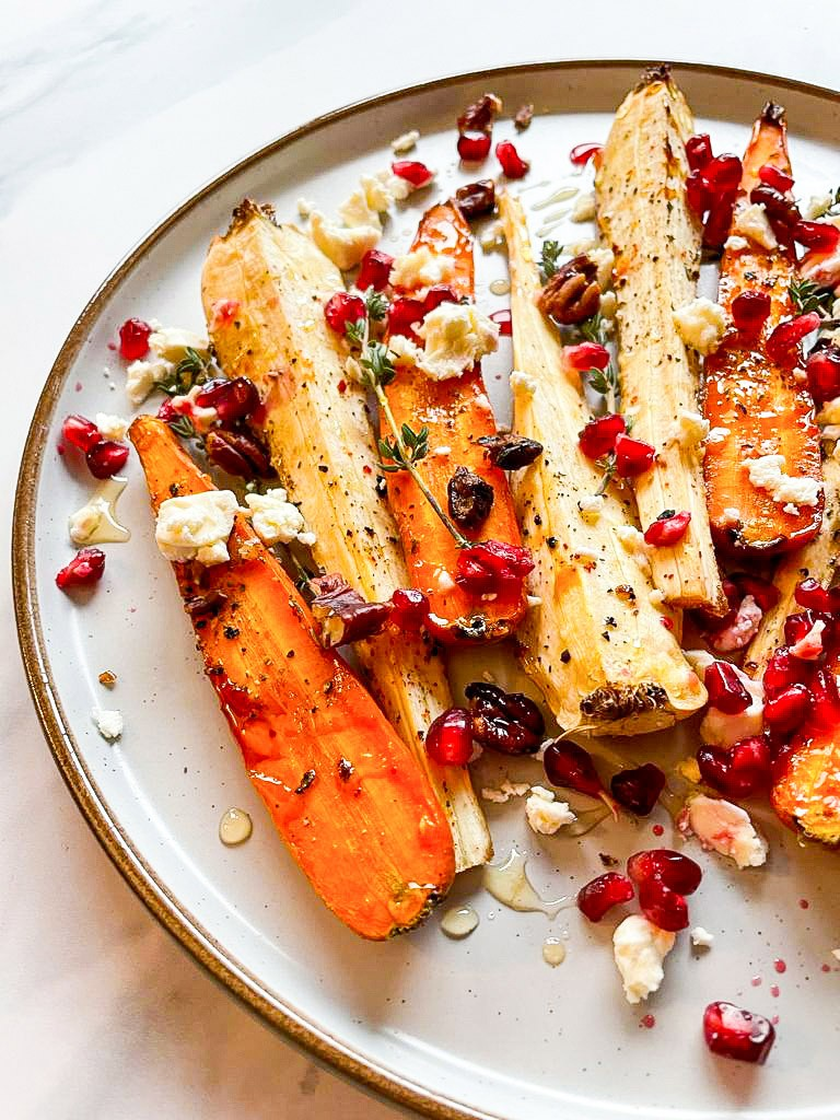 Honey Roasted Carrots & Parsnips are served on the plate on the white table #carrots #honey   hurrythefoodup.com
