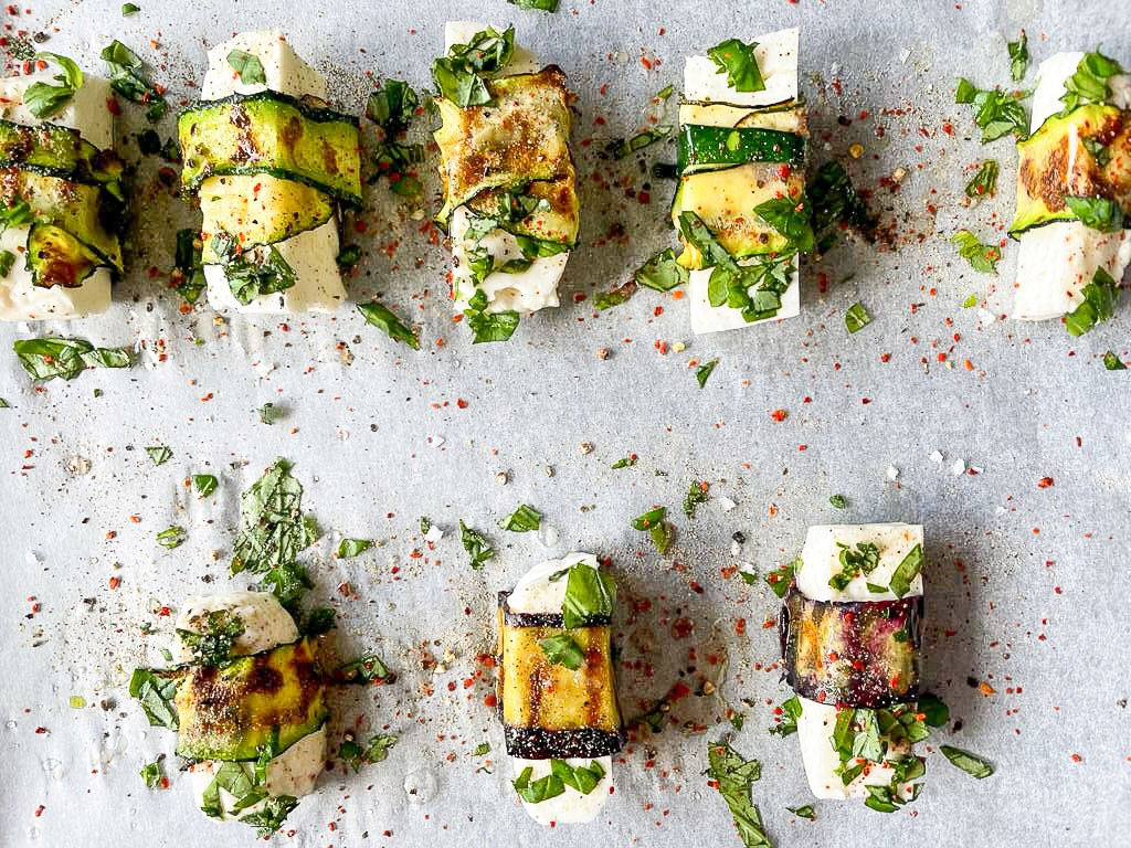 The halloumi pigs in blankets are placed on a baking tray #halloumi #courgette | hurrythefoodup.com