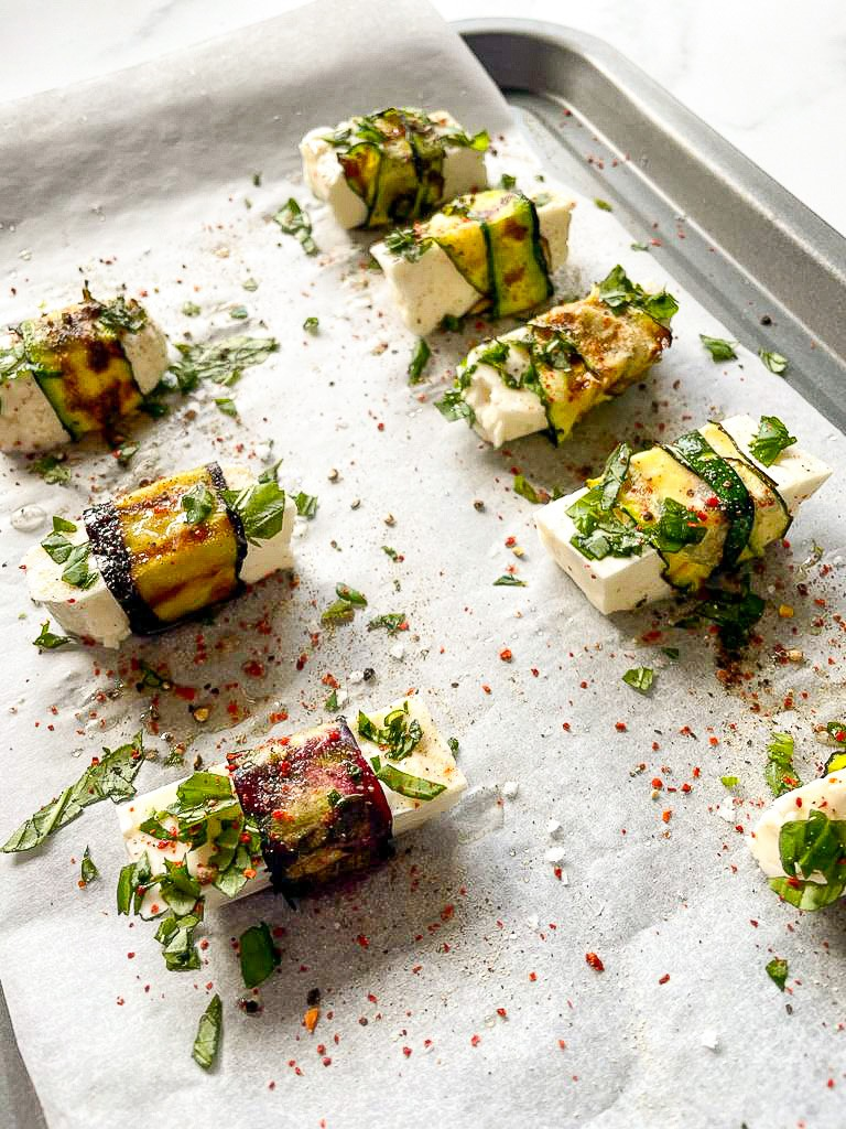 Vegetable blankets are wrapped around the halloumi pig and placed on a baking tray #aubergine #lemon juice | hurrythefoodup.com