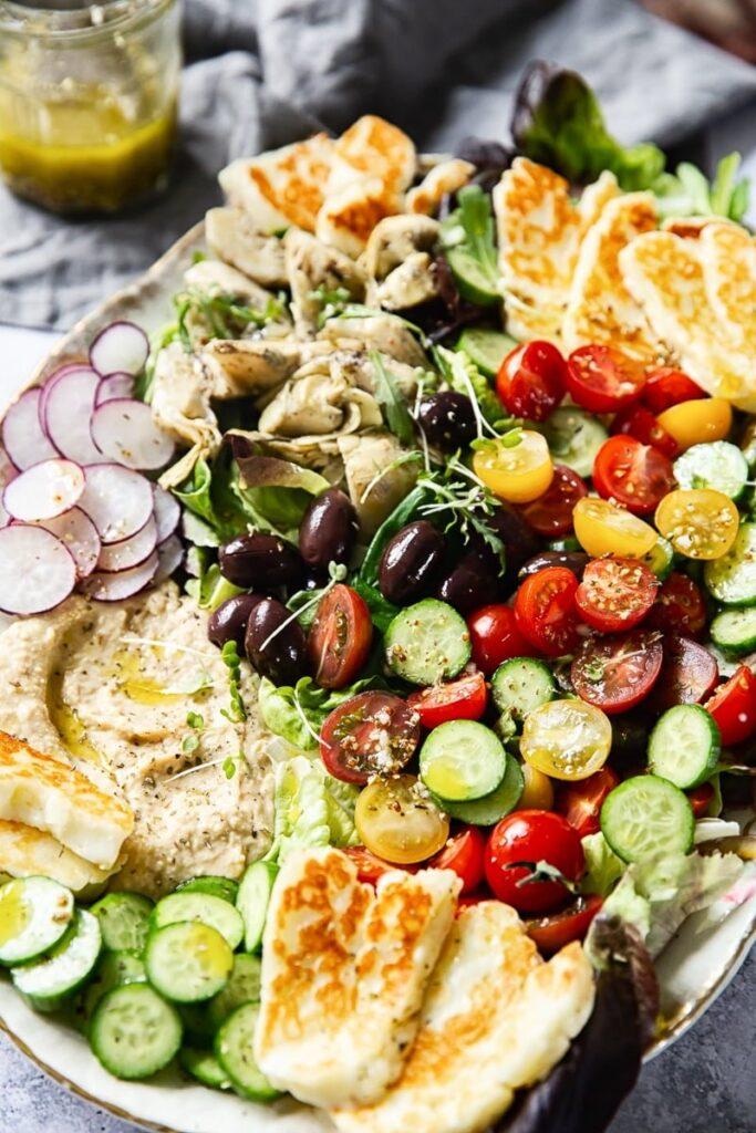 45 Summery Vegetarian Mediterranean Recipes - Mediterranean Salad with Hummus and Halloumi| Hurry The Food Up