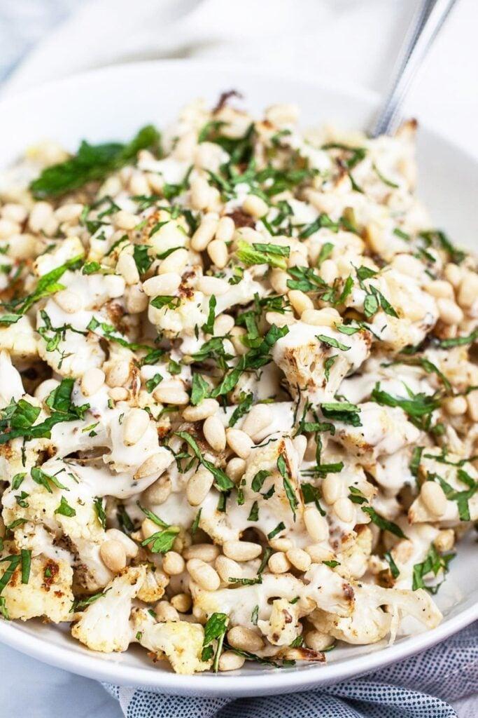 45 Summery Vegetarian Mediterranean Recipes - Mediterranean Cauliflower with Tahini| Hurry The Food Up