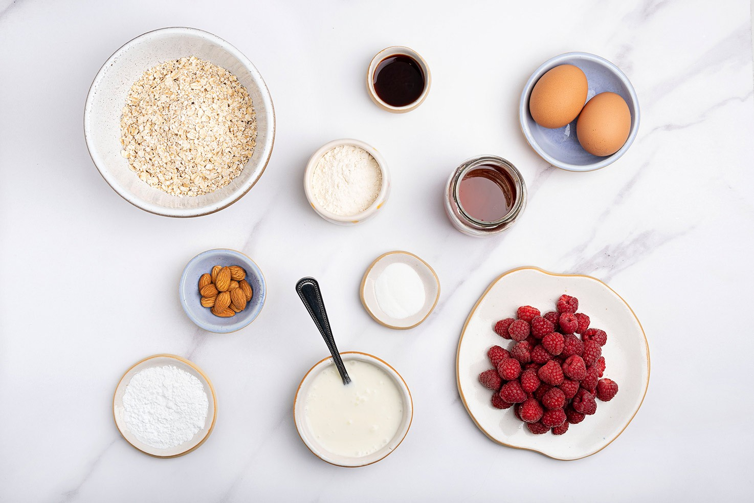 Ingredients for low calorie pancakes such as raspberries, raw oats, yogurt, baking powder, honey etc. | Hurry The Food Up
