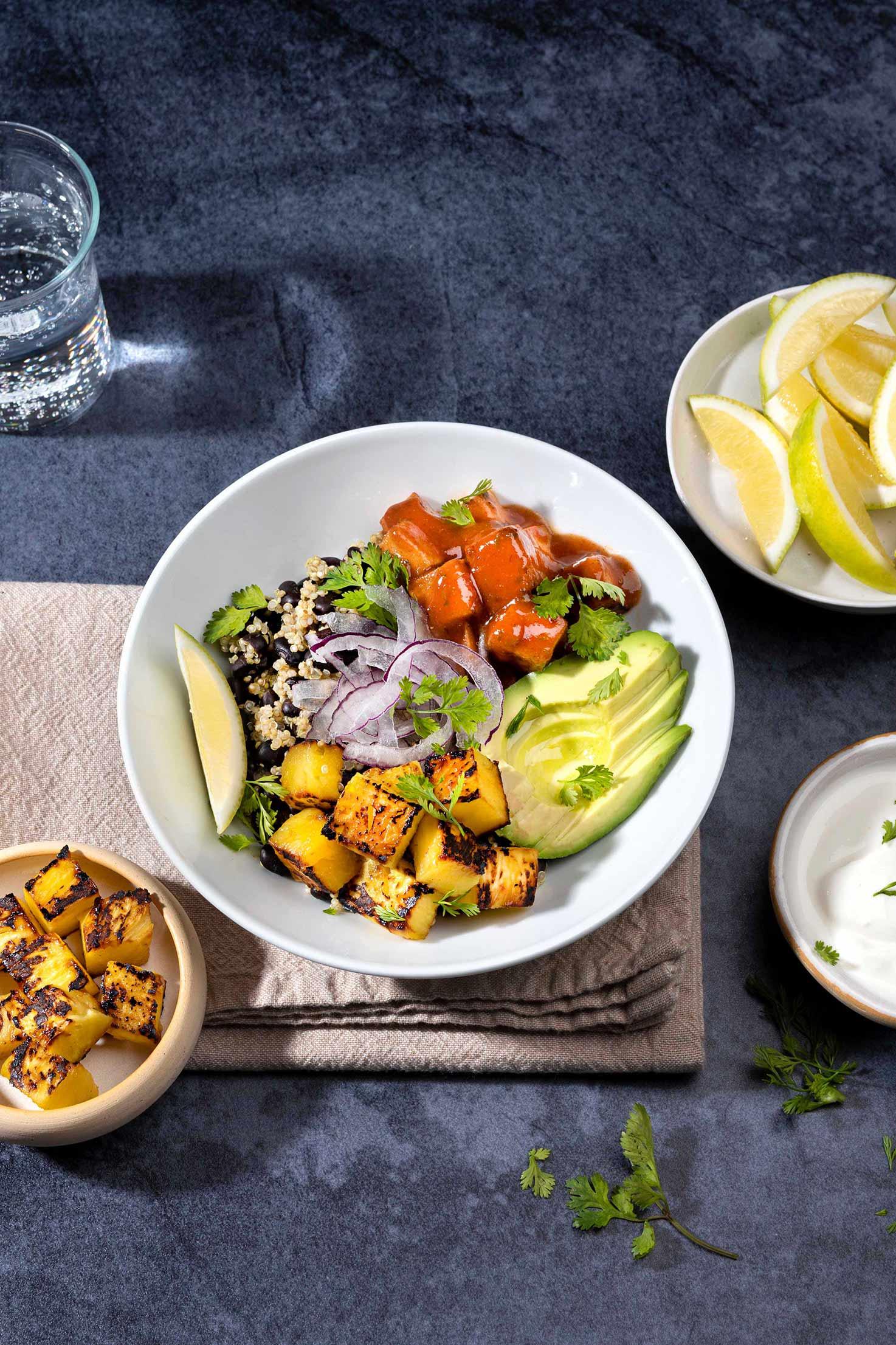 Black Bean Burrito Bowl is served with greek yogurt, lemon wedges, cilantro and fried tofu | Hurry The Food Up