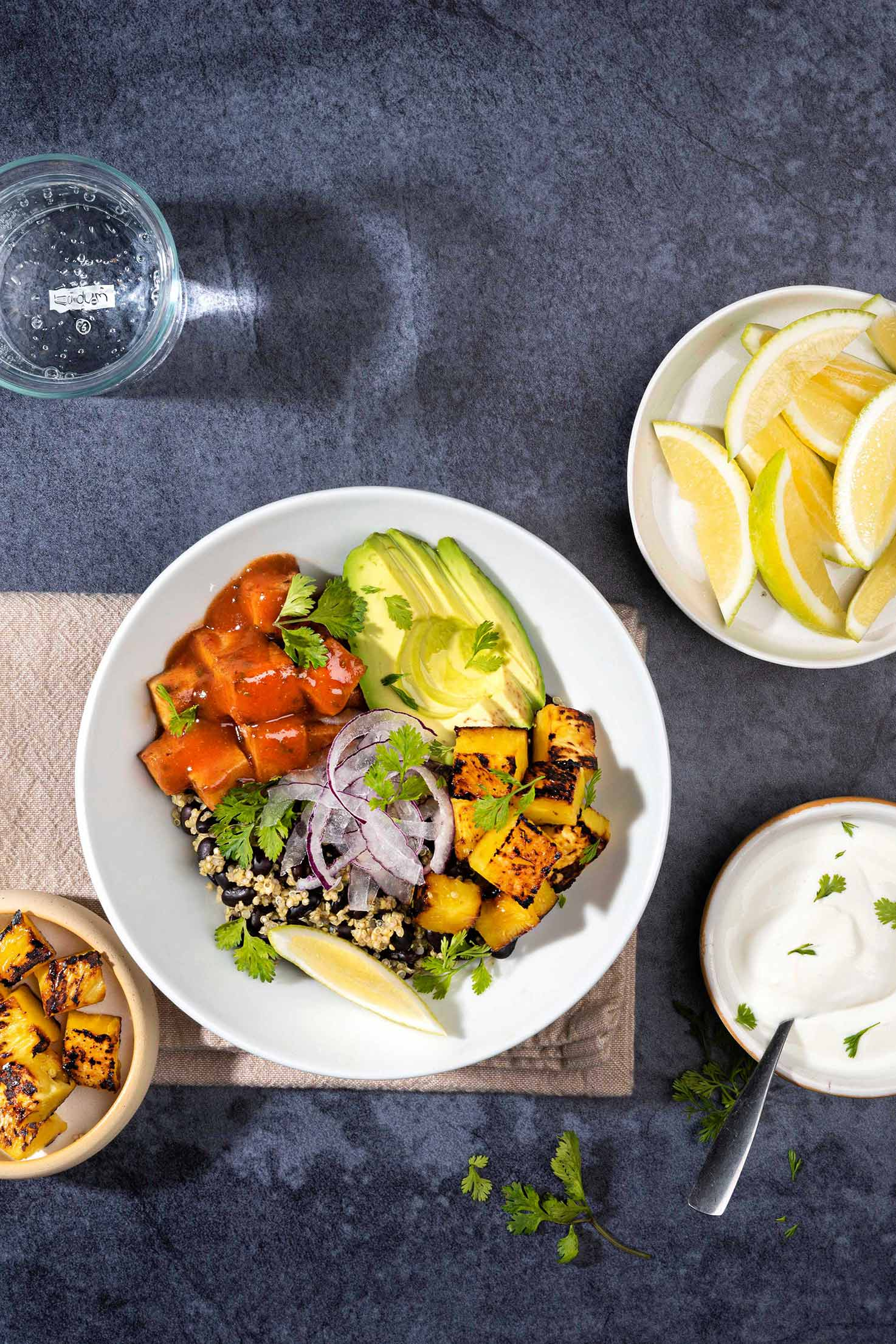 Black Bean Burrito Bowl is served with greek yogurt, lemon wedges, cilantro and fried tofu on the side | Hurry The Food Up
