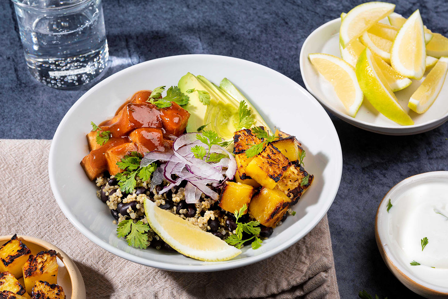 Burrito Bowl is ready for munching served with greek yogurt, lemon wedges, cilantro and fried tofu on the side | Hurry The Food Up