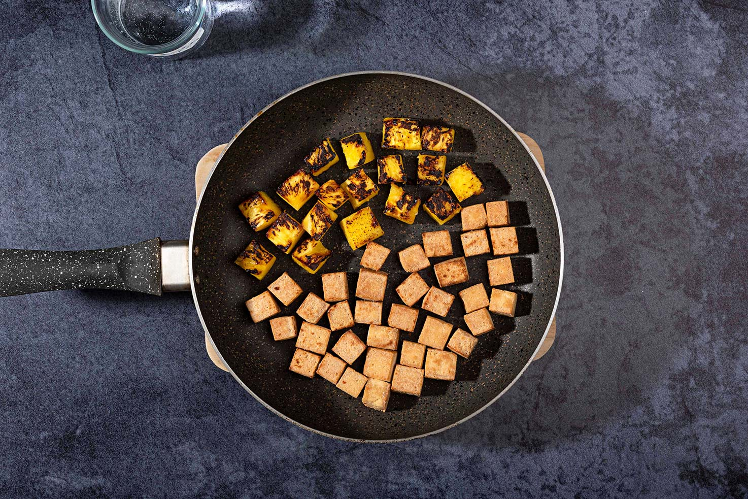Tofu and pineapple cubes are frying in the pan | Hurry The Food Up