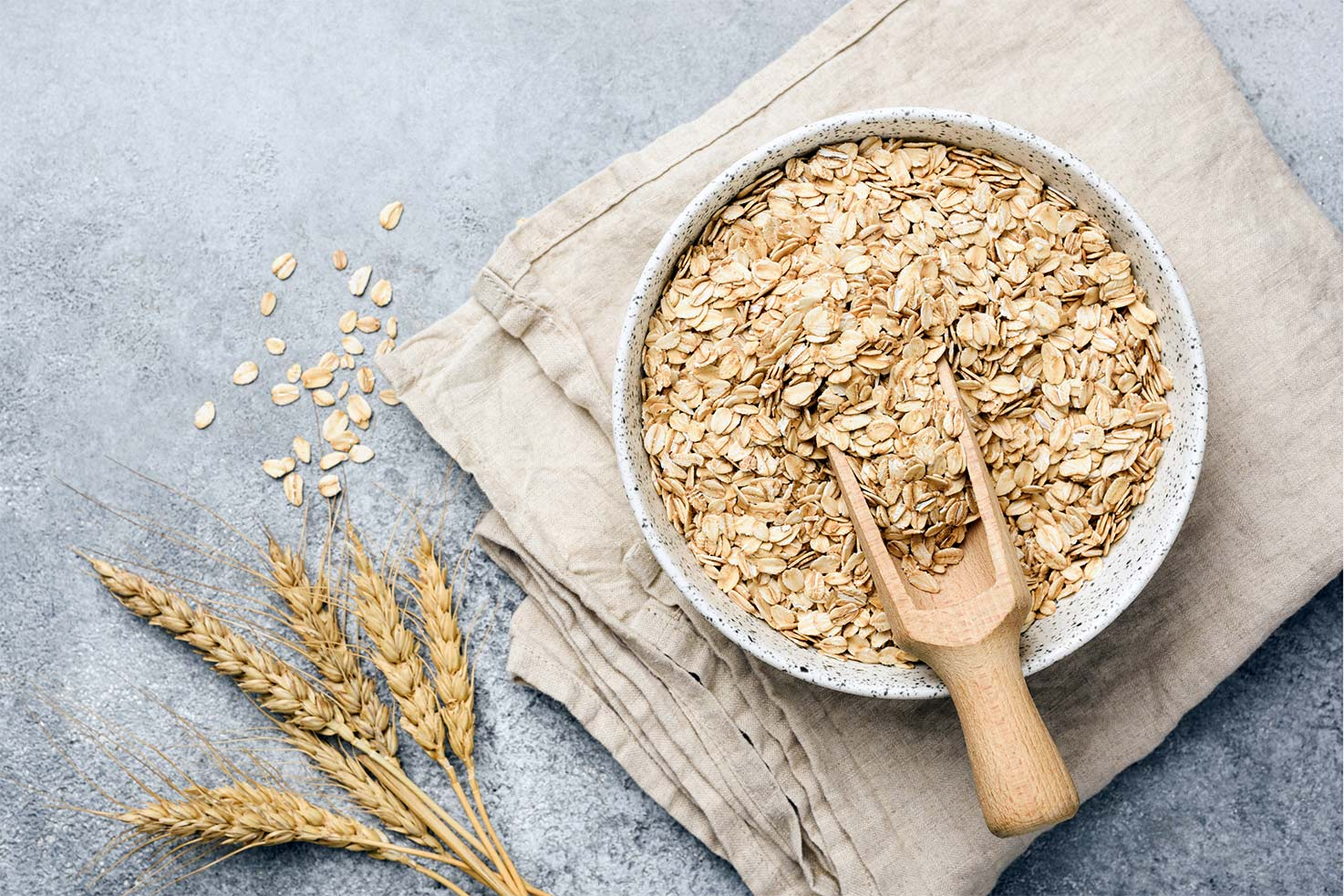 Oat flakes with wooden spoon are in the bowl that is on the table | Hurry The Food Up