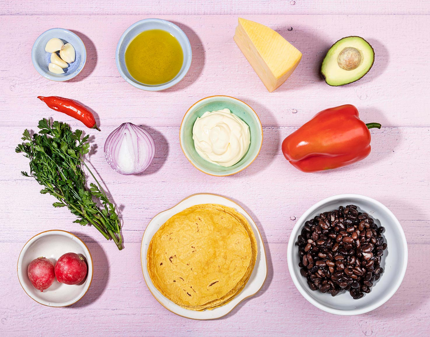The recipe ingredients like black beans, olive oil, cheddar, tortillas, bell pepper, radishes, cilantro etc. | Hurry The Food Up