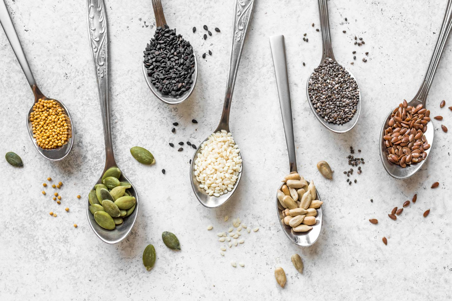 Various seeds assortment on the teaspoons | Hurry The Food Up