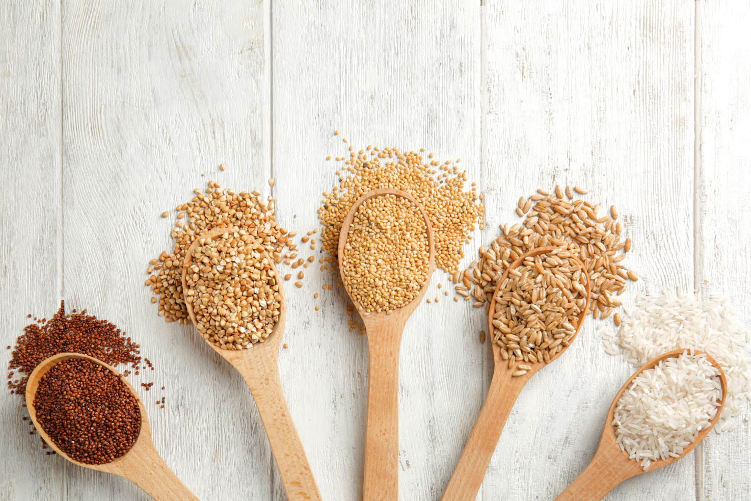 Different grains in the wooden spoons | Hurry The Food Up